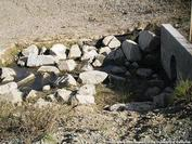 Use of riprap to dissipate the energy of drainage runoff creates condition favorable for mosquito production.