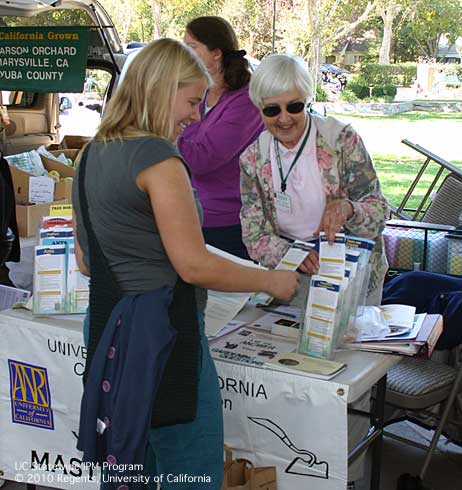 Master Gardeners give pest management advice at the Davis Farmers Market.